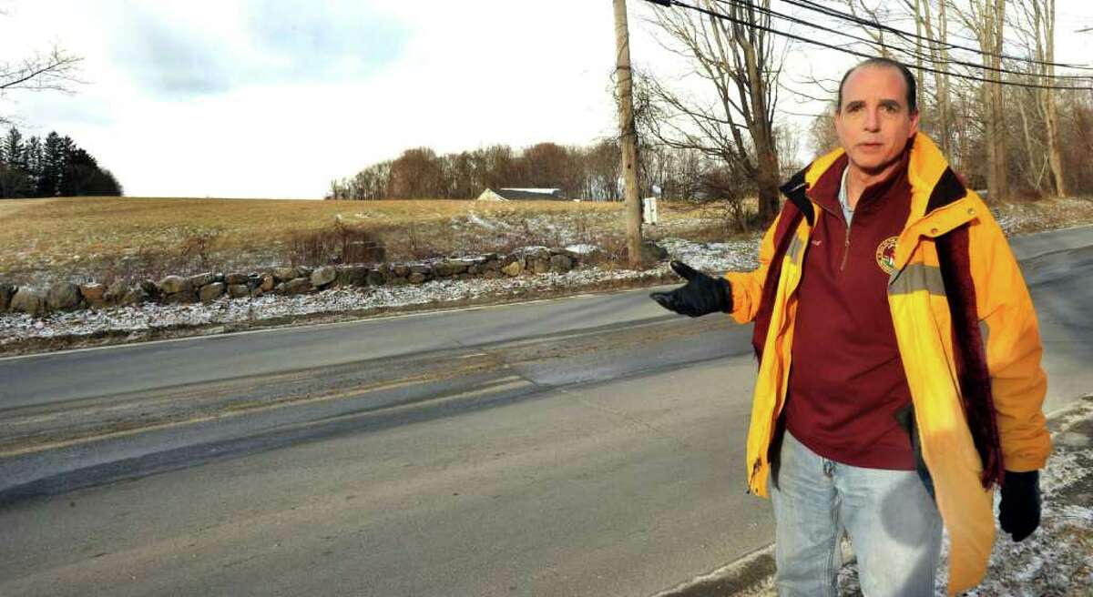 City Councilman Paul Rotello stands opposite the site on the Lee Farm property in Danbury where the U.S. Army Reserve would build an Army Reserve training center, Wednesday, Dec.15, 2010.