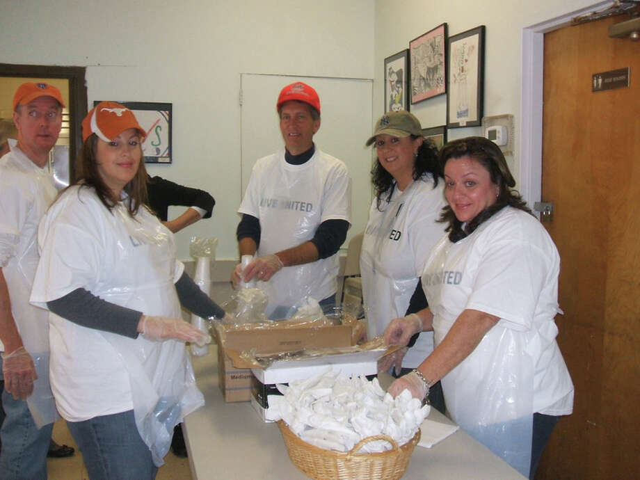 Terex Corporation's employees recently took time from their busy workdays to prepare and serve lunch to clients of Norwalk's Open Door Shelter. Pictured are Terex volunteers, from left, Michelle Tomlin, Chris Farrell, Dave Peterson, Yola Smeriglio and Elizabeth Magliari. Photo: Contributed Photo / Westport News