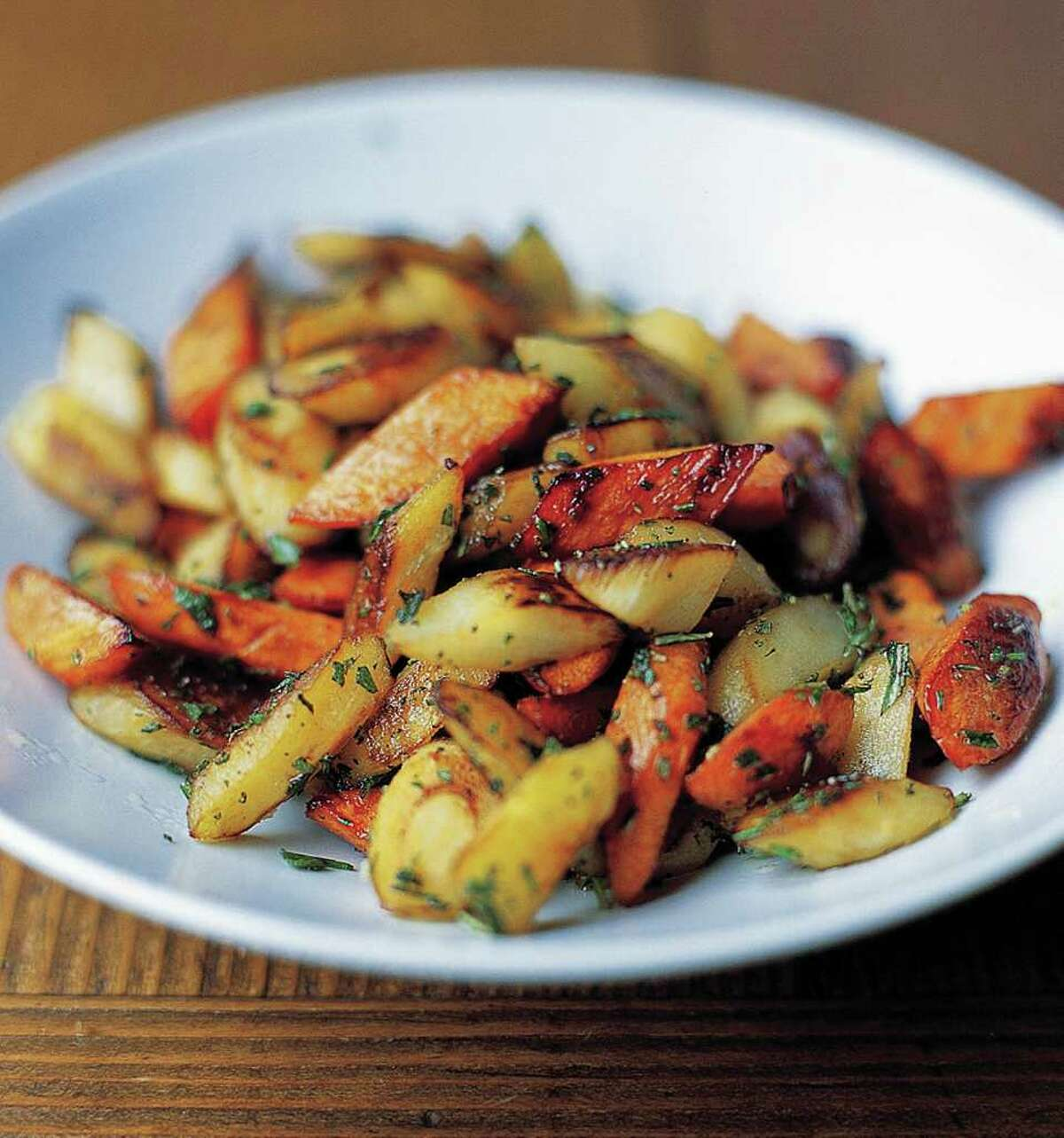 Whip up an easy side dish this December by roasting root vegetables such as carrots, parsnips and turnips. (Ben Fink / Culinary Institute of America)
