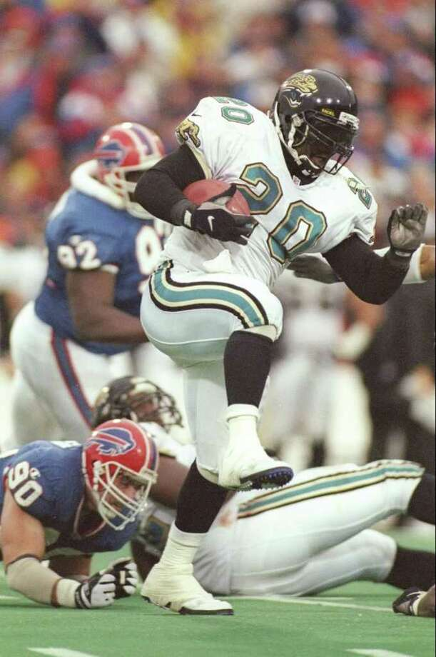 28 Dec 1996:  Running back Natrone Means of the Jacksonville Jaguars #20 carries the football during the Jaguars 30-27 AFC Playoff win over the Buffalo Bills at Rich Stadium in Orchard Park, New York. Mandatory Credit: Andy Lyons  /Allsport Photo: Andy Lyons, Getty Images / Getty Images North America