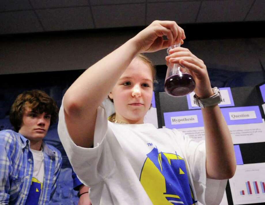 Eastern Middle School seventh-grader, Karla Cox, 11, demonstrates a pH water test that students used during a coastal science investigation with SoundWaters in which water quality tests were conducted on the Long Island Sound watershed, during a meeting held at Greenwich Town Hall where the students discussed thier findings, Wednesday night, Dec. 15, 2010. Photo: Bob Luckey / Greenwich Time