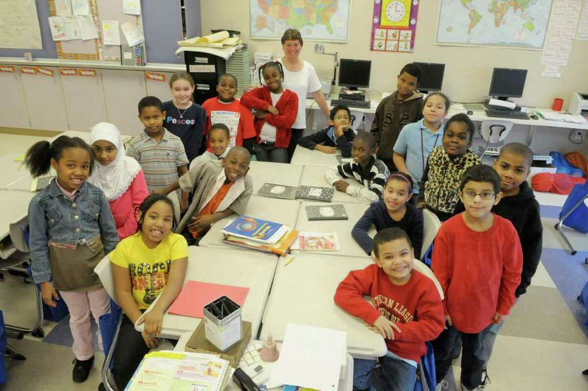 Teacher Deann Lynch, background center, with her third grade students at Pine Hills Elementary in Albany, NY. Lynch and her students are benefiting from the Music Mobile's Hope Fund grant that will use music in schools as a learning tool. (Paul Buckowski / Times Union)