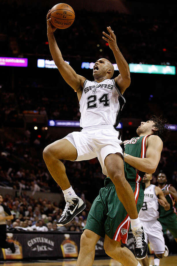 The Spurs' Richard Jefferson drives to the goal against the Bucks' Andrew Bogut during the first half at the AT&T Center, Wednesday, Dec. 15, 2010. Photo: JERRY LARA/glara@express-news.net, Express-News