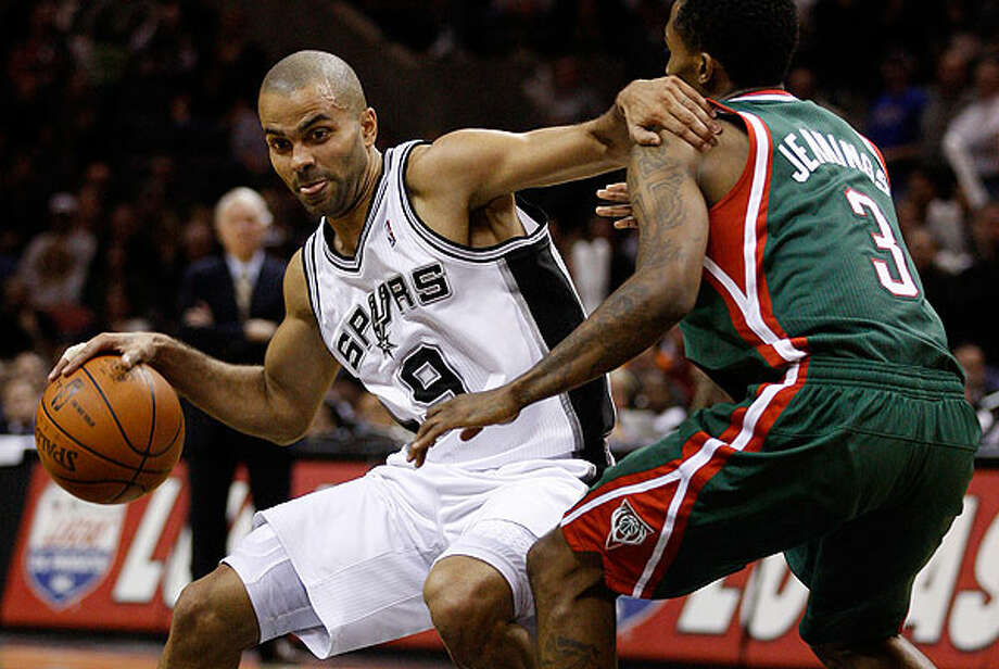 The Spurs' Tony Parker drives around the Bucks' Brandon Jennings during the second half at the AT&T Center, Wednesday, Dec. 15, 2010. The Spurs won 92-90 to improve to 21-3. Photo: JERRY LARA/glara@express-news.net, Express-News