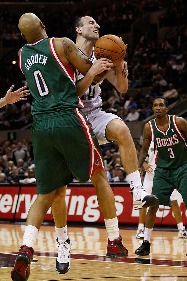 The Spurs' Manu Ginobili is fouled by the Bucks' Drew Gooden during the second half at the AT&T Center, Wednesday, Dec. 15, 2010. The Spurs won 92-90 to improve to 21-3. Photo: JERRY LARA/glara@express-news.net, Express-News