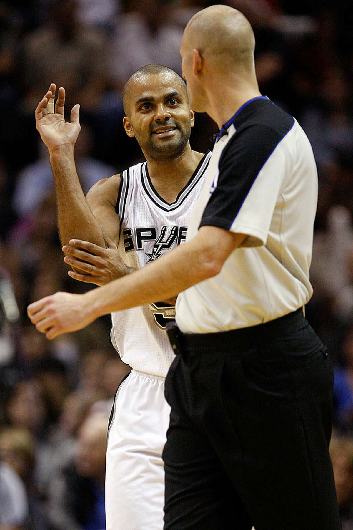 The Spurs' Tony Parker pleads his case with referee Eric Dalen during the first half against the Milwaukee Bucks at the AT&T Center, Wednesday, Dec. 15, 2010.
