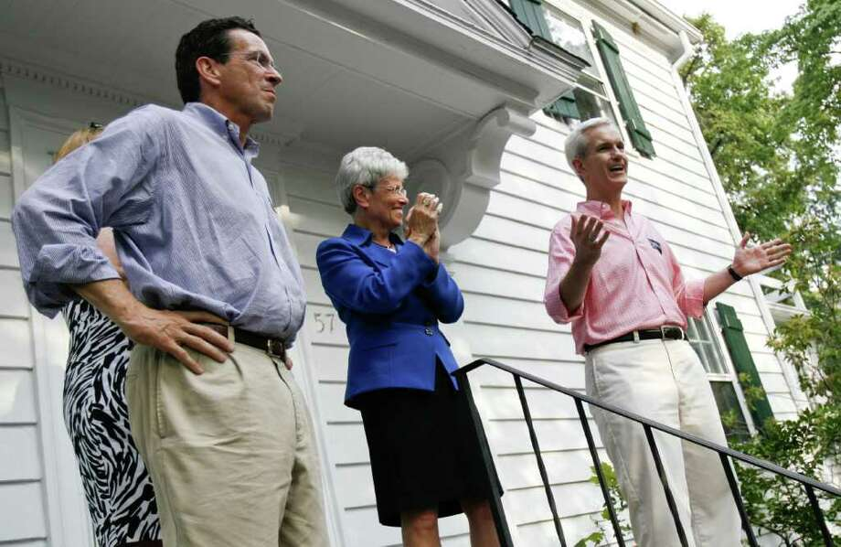 State Sen. Andrew McDonald, right, addresses a crowd of supporters rallying for then-gubernatorial candidate Dannel Malloy, left, and Lt. Gov.-candidate Nancy Wyman, center, outside of Malloy's childhood home on Revonah Avenue in Stamford on August 9, 2010. Photo: File Photo / Stamford Advocate File Photo