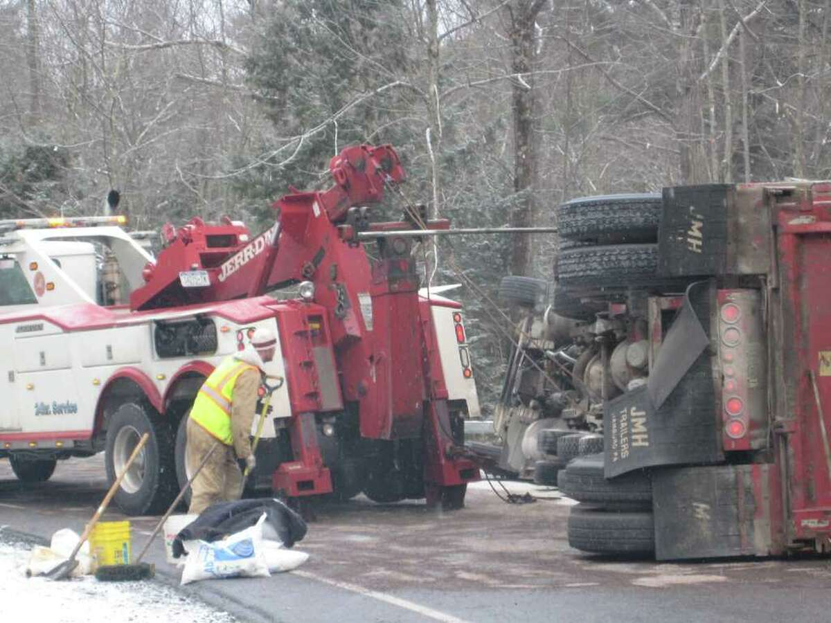 A driver at the wheel of a tractor-trailer loaded with rocks rolled over about 8:30 a.m. Thursday on Middle Grove Road in Middle Grove. (Leigh Hornbeck/Times Union)