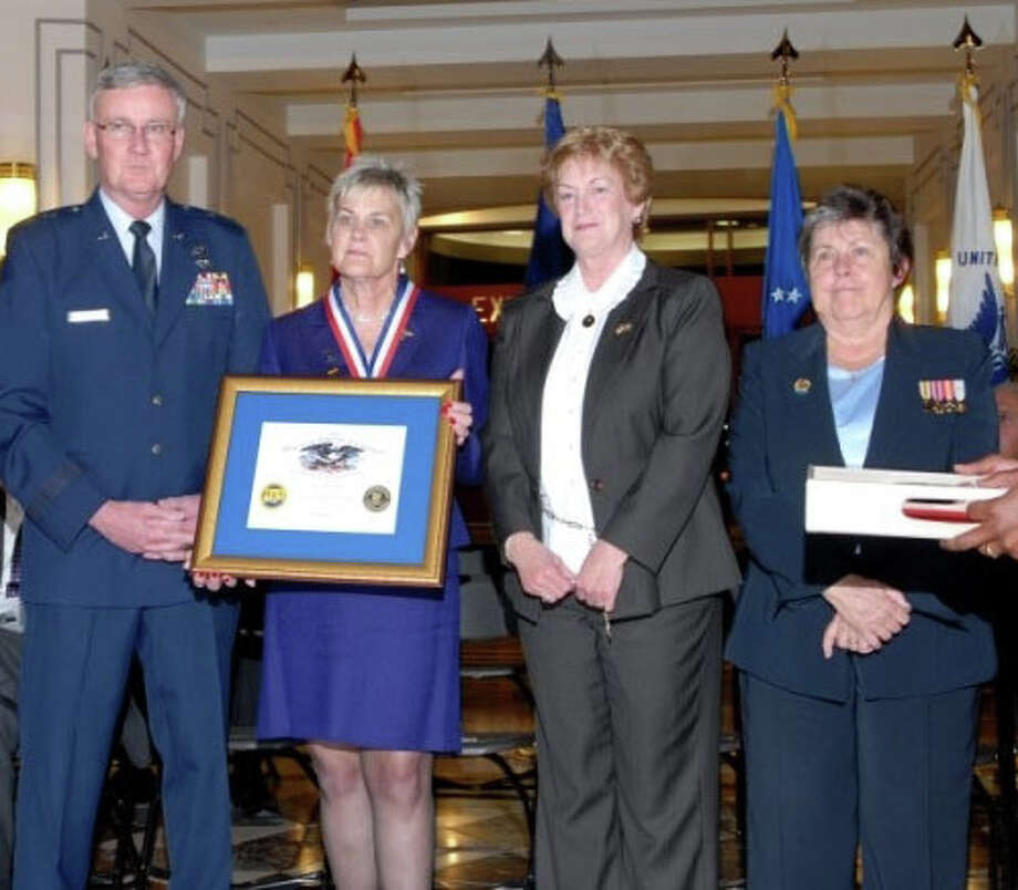 Doris Troth Lippman, second from left, appears at a Nov. 22 induction ceremony into the Connecticut Veterans Hall of Fame alongside Gov. M. Jodi Rell, second from right; Gen. Thaddeus Martin, left; and Linda Schwartz, Commissioner of the Connecticut Department of Veterans Affairs, right. Photo: Contributed Photo / Westport News contributed