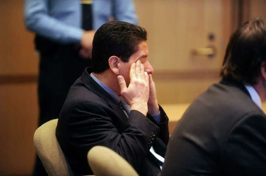 Carlos Trujillo, left, cried when he was acquitted of murder in the slaying of Andrew Kissel, at state Superior Court in Stamford on Thursday, Dec. 16, 2010. Trujillo's attorney Lindy Urso sits with him. Photo: Helen Neafsey / Greenwich Time