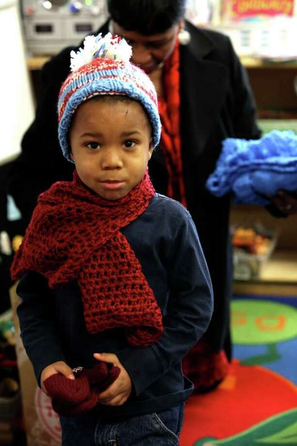 DO:Feel free to walk around the house in a hat and scarf. Photo: Francesca Andre / Connecticut Post