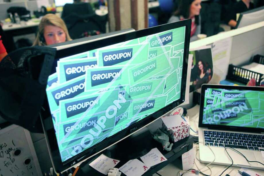 Groupon Inc. signage is displayed on the screensaver of a computer at the company's headquarters in Chicago, Illinois, U.S., on Tuesday, Dec. 14, 2010. Groupon, the startup provider of online coupons with more than 35 million users, rejected a $6 billion offer from Google Inc. earlier this month, betting it can keep increasing its valuation. Photographer: Tim Boyle/Bloomberg Photo: Tim Boyle, Bloomberg / © 2010 Bloomberg Finance LP