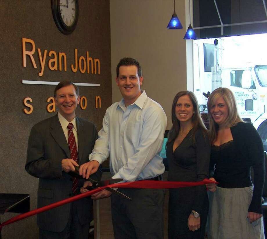 The Ryan John Salon opened recently at 1630 Post Road from its previous site, 58 Post Road in the Grasmere neighborhood. Here at the ribbon cutting are, from left, First Selectman Kenneth Flatto, owner Ryan Recupero, his wife, Michele, and his sister, Tiffany, who works at the salon. Photo: Contributed Photo / Fairfield Citizen contributed