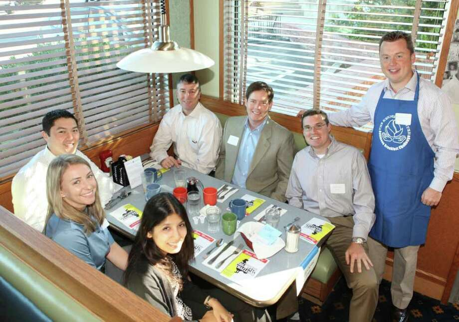 GE Capital in Fairfield Business Breakfast Challenge teammates include (left row) Sobia Khaliq, Laura Scerbo and Nathan Suh and (right row) Stephen Burke, captain, standing; Colin Torrance, Peter Foley and George Neamonitis. Foley is vice chairman of the board of directors of The Kennedy Center. Photo: Contributed Photo / Fairfield Citizen contributed
