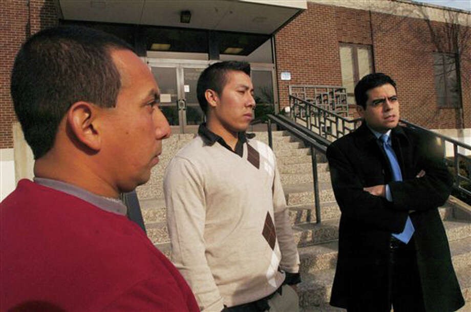 Emilio and Marvin Morales, relatives of Jose Joaquin Morales, stand with their attorney Alex Martinez outside the Norwalk Superior Court Thursday, Dec. 16, 2010 in Norwalk, Conn.  Thirty-two-year-old Jose Joaquin Morales of Stamford was shot in the head during an October 2009 robbery. He died two days later after family members decided to remove him from life support.   Twenty-two-year-old Alain Leconte and 24-year-old Mustafa Jacobs are scheduled to be arraigned Thursday in Norwalk Superior Court for their roles in the robbery of the West Haven Avenue gas station. Investigators say Morales and patrons were ordered to lie on the floor during the robbery. As the suspects were leaving, one turned and shot Morales. (AP Photo/The Hour/ Erik Trautmann) Photo: Erik Trautmann, AP / (C)2010 The Hour