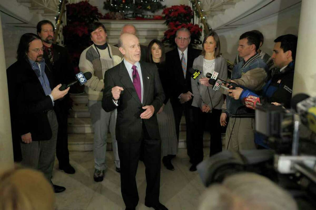 Roger Hull, the former president of Union College, and other members of the Alliance Party hold a press conference in the rotunda of Schenectady City Hall on Thursday, Dec. 16, 2010. Hull is challenging Mayor Brian Stratton in next year's election and the Alliance Party will put forth candidates for City Council. The Alliance Party, a group of Democrats, Republicans and independents, was formed 18 months ago to field candidates in the 2011 election. (Paul Buckowski / Times Union)
