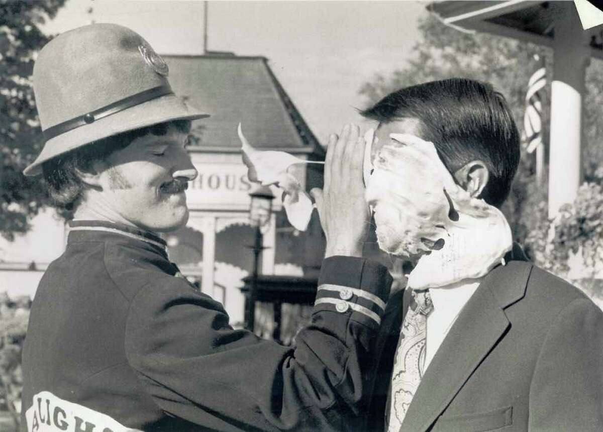 Gerald Solomon gets caught in a pie fight at Gaslight Village in Lake George on July 31, 1977.