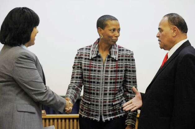 Gwen Ambres, center, is congratulated by BISD attorney Melody Chappell, left, and BISD president Woodrow Reece after being sworn in as the new BISD board member, replacing Howard Trahan, the board member who died recently. Thursday, December 16, 2010 Valentino Mauricio/The Enterprise Photo: Valentino Mauricio / Beaumont