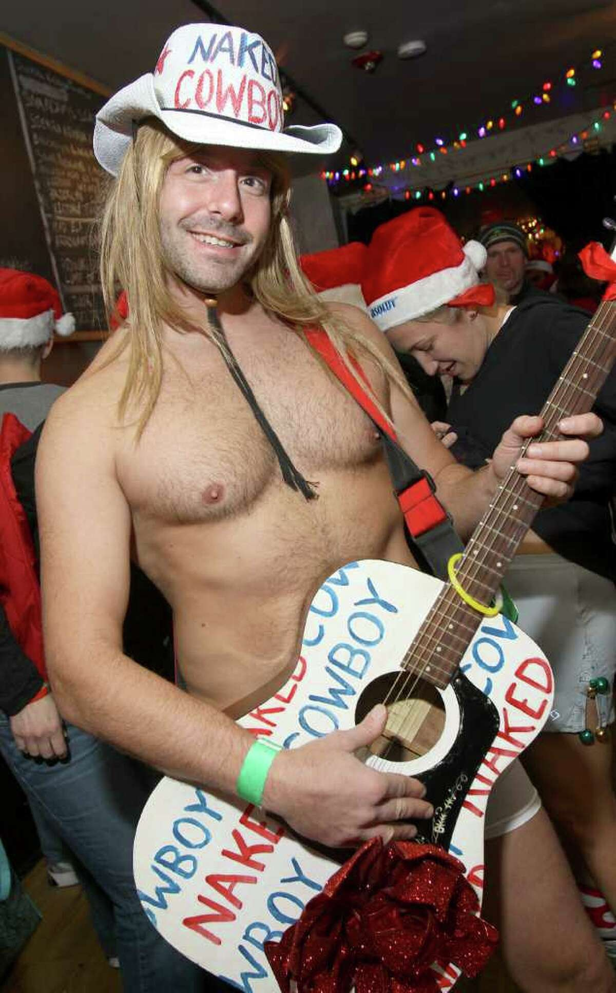 Rob Schweizer channels the Naked Cowboy at the Lionheart before the start of the Santa Speedo Sprint. (Joe Putrock / Special to the Times Union)