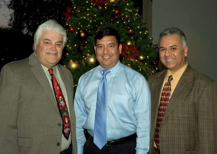 OTS/HEIDBRINK. Co-founders Edward Hopkins, Ruben Lopez and Richard Rodriguez get together at the Alamo Inventors' Christmas party at the San Antonio Technology Building. Photo by Jamie Karutz. Photo: Jamie Couch Karutz / San Antonio Express-News