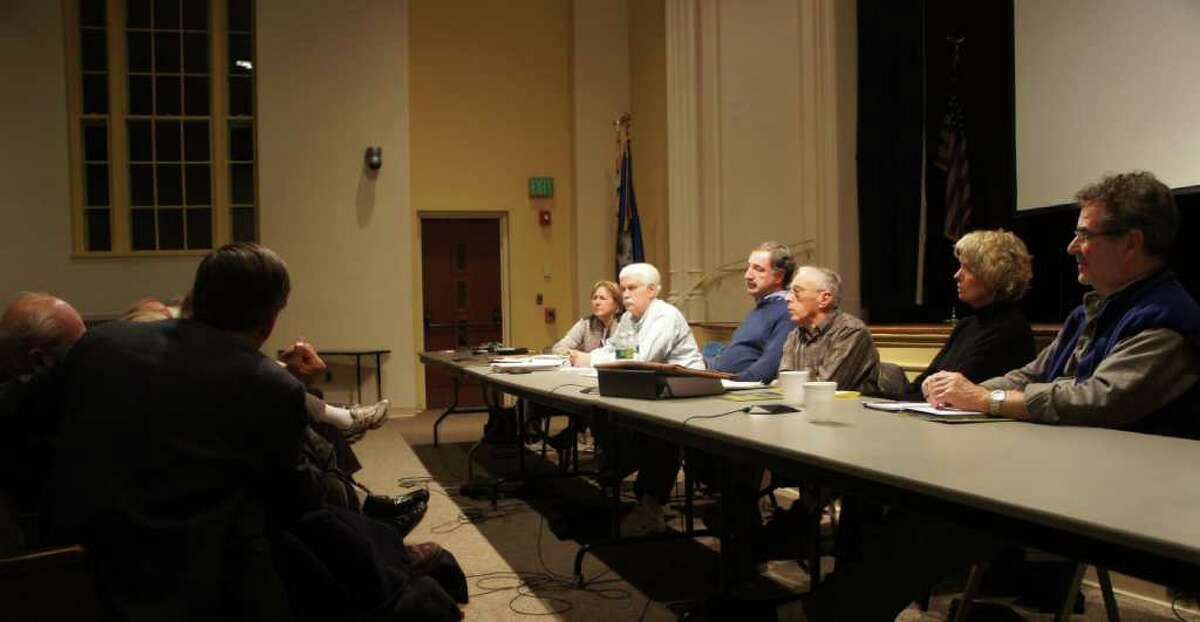 Members of the RTM's Public Protection, Environment, and Health and Human Services Committees confer during a meeting on Westport's deer control policy on Thursday, Dec. 16, 2010.