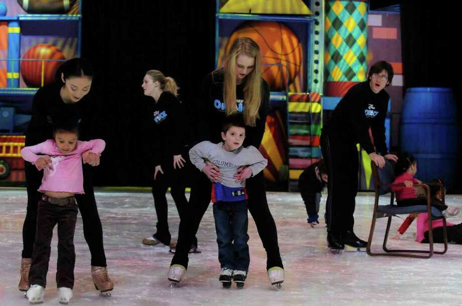 Disney on Ice Toy Story 3 skaters help children around the ice during a Disney on Ice Make-A-Wish skating Party at the Times Union Center in Albany. ( Michael P. Farrell/Times Union ) Photo: Michael P. Farrell
