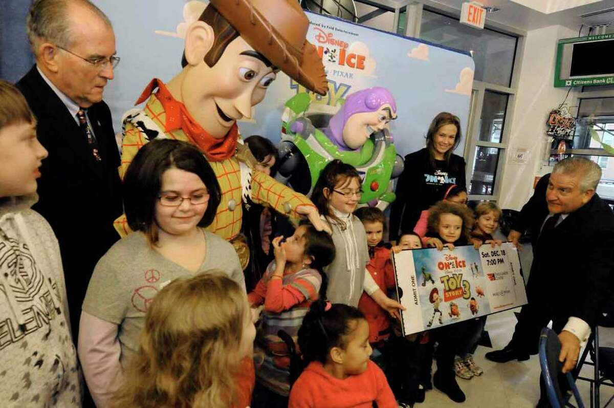 Children get to meet Albany County Executive Mike Breslin, Disney on Ice Toy Story 3 characters Woody and Buzz as well as Albany Mayor Jerry Jennings during a Disney on Ice Make-A-Wish skating Party at the Times Union Center in Albany. ( Michael P. Farrell/Times Union )