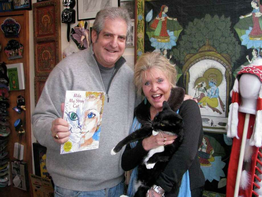 "Co-authors of the new book ""Milo, My Stray Cat"" Don Cohen and Gayle Gleckler. Photo: Contributed Photo/Mike Lauterborn, Contributed Photo / Westport News contributed"