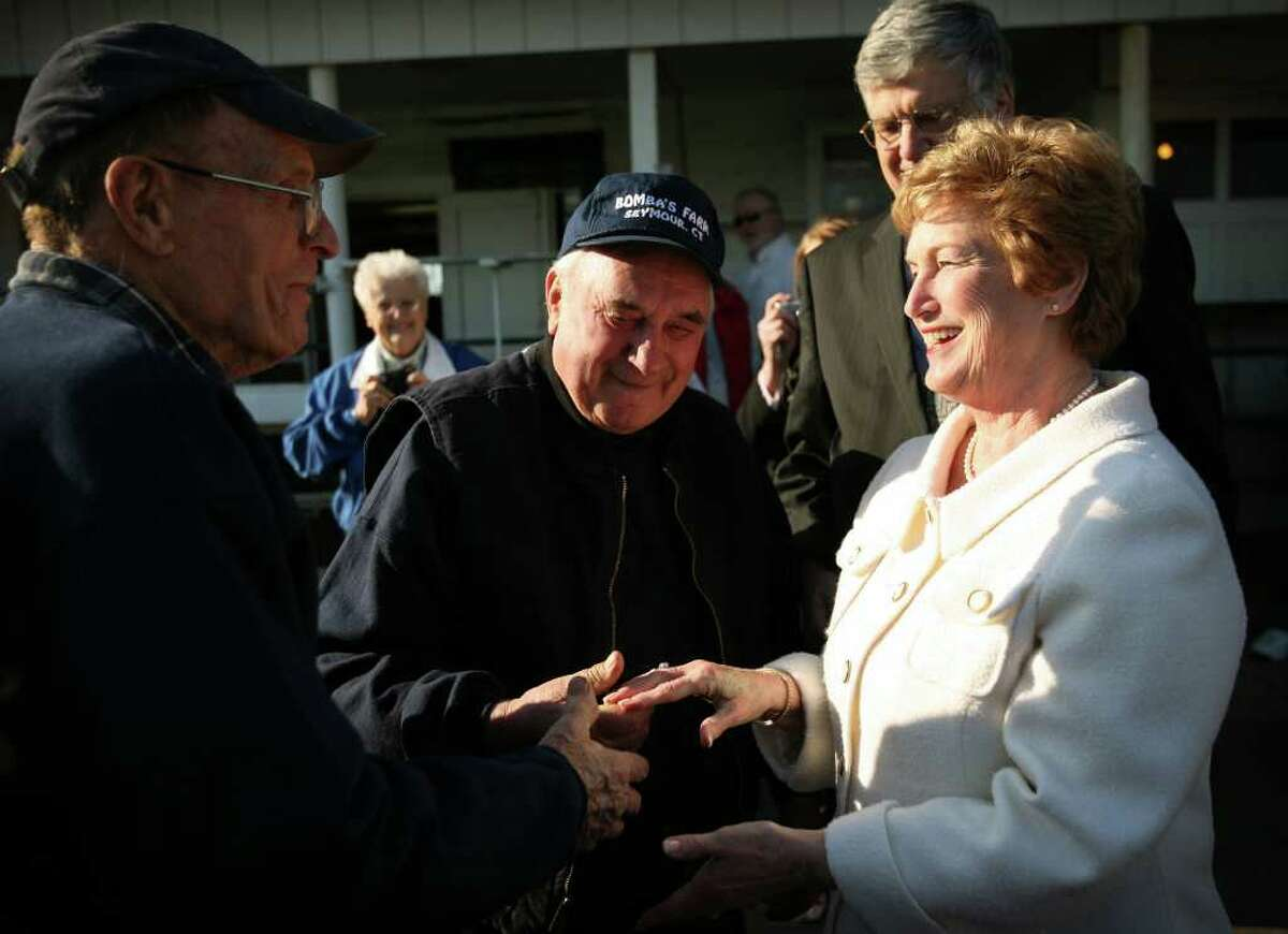 Governor M. Jodi Rell, right, greets brothers Ed, left, and Gene Bomba at Bomba's Farm in Seymour on Monday, March 8, 2010. Rell announced that $5 million in state money will be used to purchase the development rights to farmland, including the Bomba Farm, the last working farm in Seymour.