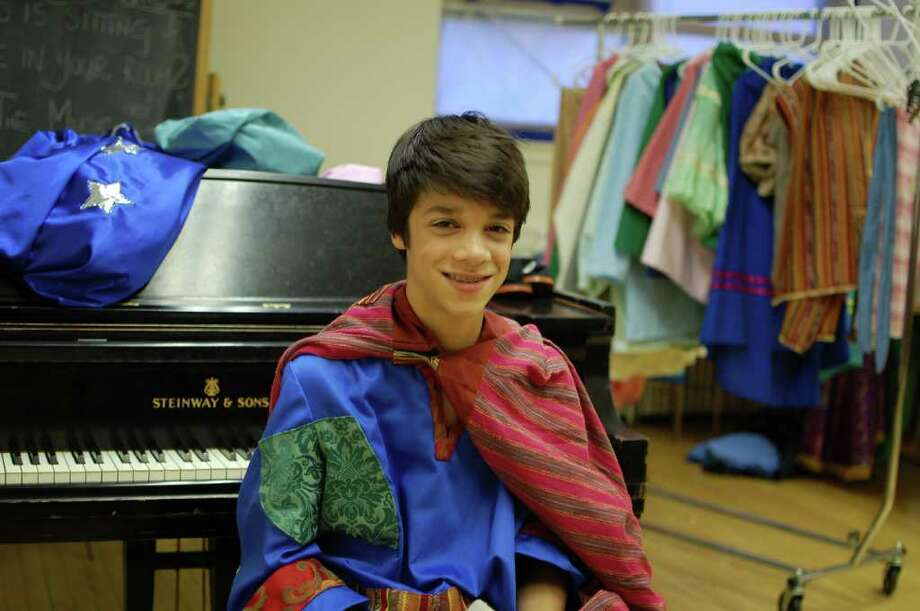 "Eli Abbasi, a 13-year-old Riverside resident, in costume during rehearsal for ""Amahl and the Night Visitors"" in New York City this week. Eli will be playing the title role in the opera at Avery Fisher Hall at Lincoln Center on Saturday, Dec. 18. (Photo by Lisa Chamoff/staff) Photo: Contributed Photo / Greenwich Time Contributed"