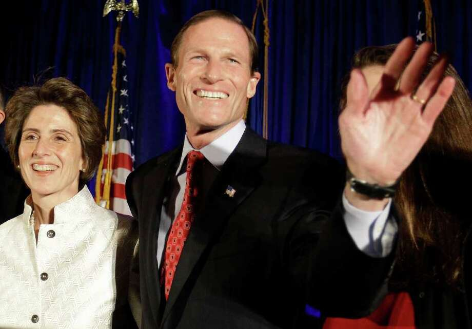 In this Nov. 2 photo, Connecticut Attorney General and newly elected U.S. Sen. Richard Blumenthal, D-Conn., and his wife Cynthia celebrate during his election night rally in Hartford. (AP Photo/Stephan Savoia) Photo: Contributed Photo, ST / Greenwich Time Contributed