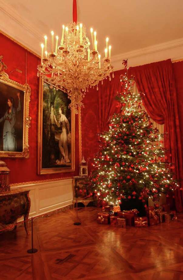"A Christmas tree sparkles in the ante room of Waddesdon Manor in Buckinghamshire, England. The French-style English home of Baron Ferdinand de Rothschild is one of 30 houses featured in ""Christmas at Historic Houses"" by Patricia Hart McMillan and Katherine Kaye McMillan. / San Antonio Express-News"