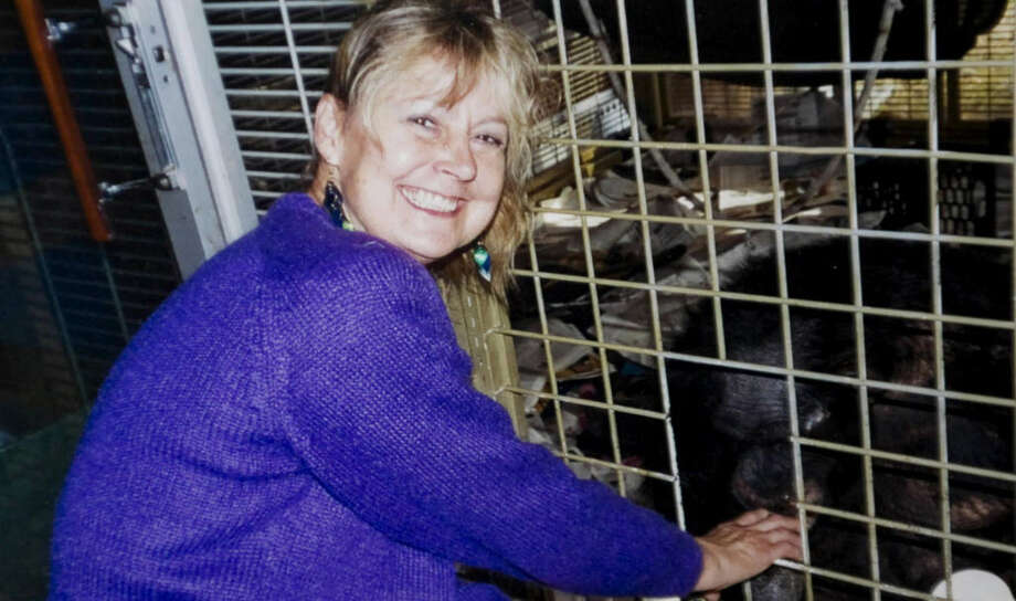 Charla Nash in a 2007 photo next to the cage with the chimpanzee Travis. Nash, who was later mauled by Travis, returned to Stamford Hospital to thank the staff for her recovery. Photo: File Photo, ST / Stamford Advocate File Photo