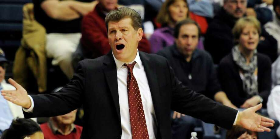 In this photo taken Thursday, Dec. 9, 2010, Connecticut coach Geno Auriemma reacts during an NCAA women's college basketball game at Storrs, Conn. UConn defeated Marquette 79-47 to win their 87th straight game. (AP Photo/Bob Child) Photo: AP