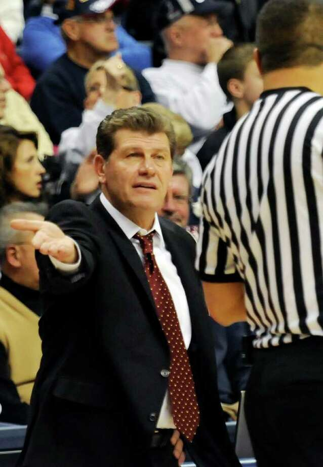 In this photo taken Thursday, Dec. 9, 2010, Connecticut coach Geno Auriemma speaks to an offficial during an NCAA women's college basketball game at Storrs, Conn. UConn defeated Marquette 79-47 to win their 87th straight game. (AP Photo/Bob Child) Photo: AP