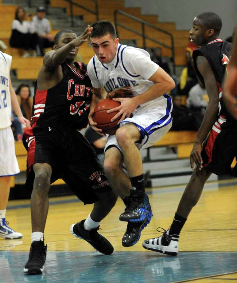 Fairfield Ludlowe's #11 Kevin Bentivegna, center, tries to get past Central's #33 Ruhan McNeil, during boys basketball action in Fairfield, Conn. on Friday December 17, 2010. Photo: Christian Abraham / Connecticut Post
