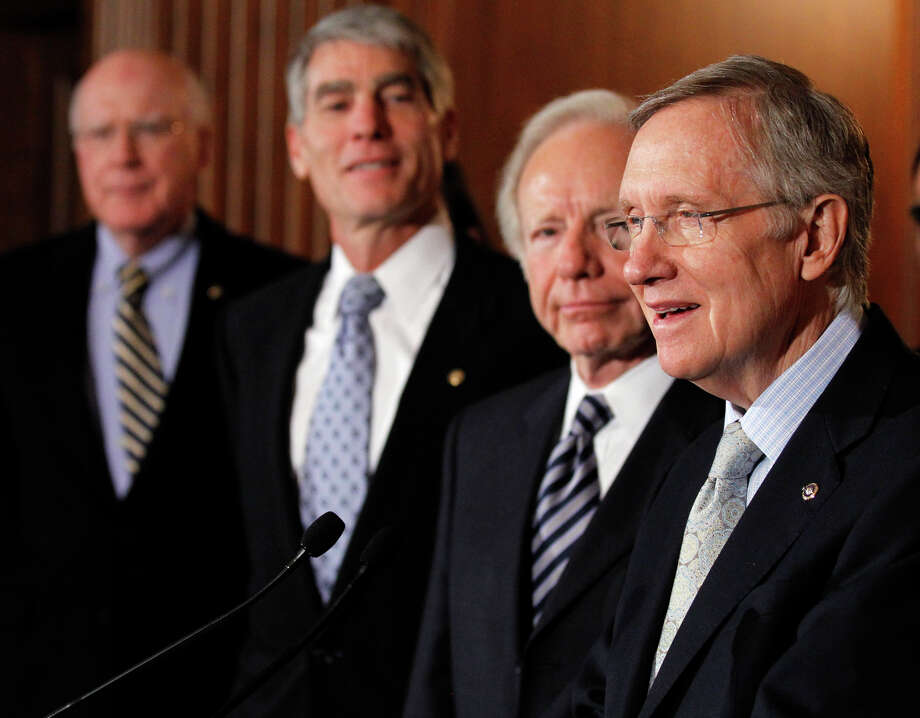 "Senate Majority Leader Sen. Harry Reid, D-Nev. (from right) speaks as he stands with Sen. Joesph Lieberman, I-Conn., Sen. Mark Udall, D-Colo., and Sen. Patrick Leahy, D-Vt., at a news conference about the ""Don't Ask Don't Tell"" bill during an unusual Saturday session on Capitol Hill in Washington Saturday. Photo: Alex Brandon/Associated Press / AP2010"