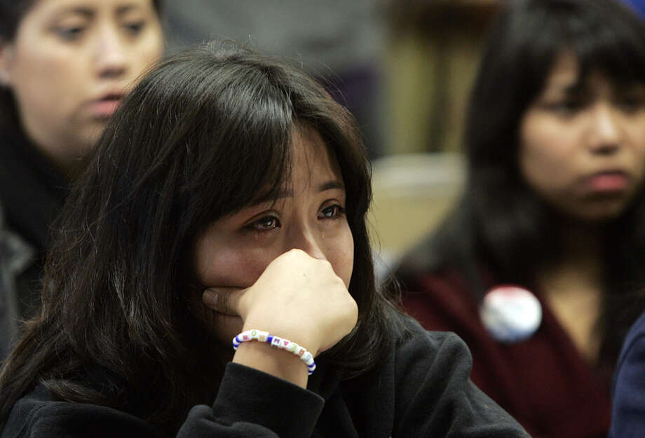 Undocumented UCLA student Leslie Perez, 22, weeps while watching a televised debate of the Dream Act in the Senate at the UCLA Downtown Labor Center in Los Angeles, Saturday. Perez is an undocumented student at UCLA. Photo: Jason Redmond/Associated Press