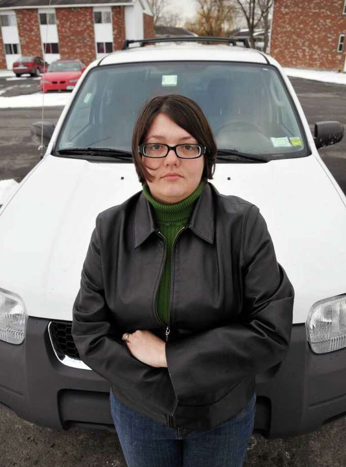 Heidi Donlon stands next ot her car outside her Colonie home Thursday afternoon.  (John Carl D'Annibale / Times Union) Photo: John Carl D'Annibale / 00011342A