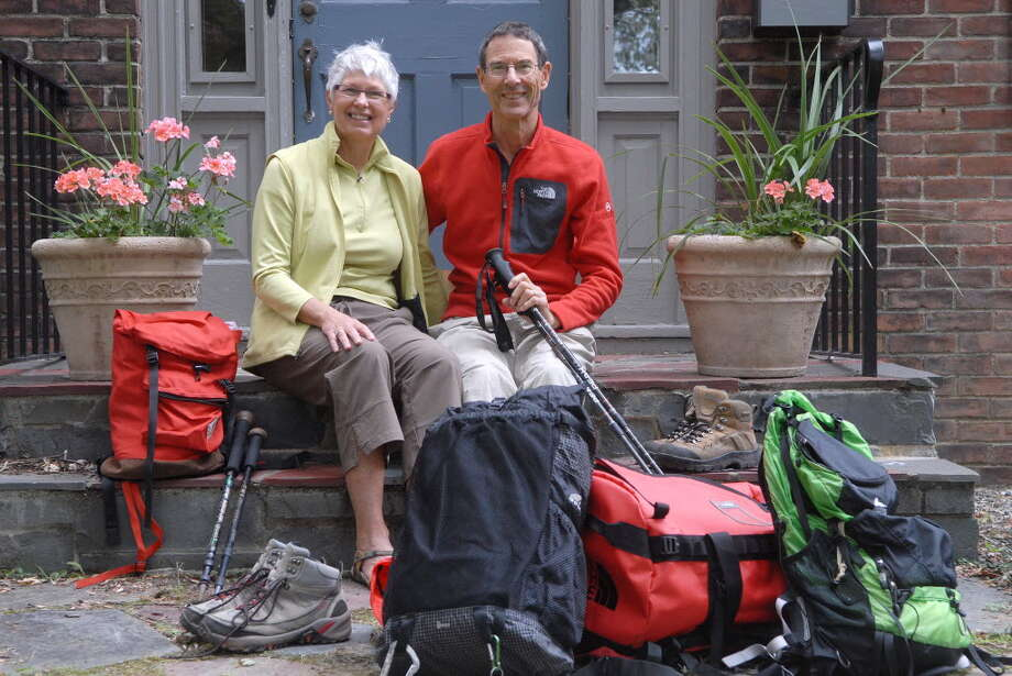 Linda and David Burtis surrounded by some of their hiking gear in September at their Delmar home before setting off to climb Mount Kiliminjaro.  (Paul Buckowski / Times Union)