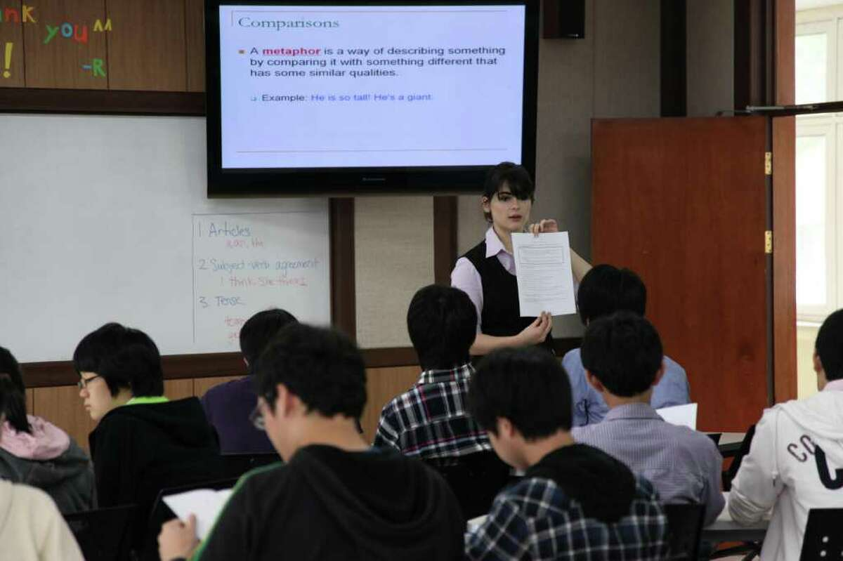 In her second year as a Fulbright fellow teaching English in the South Korea, Greenwich High School alumnus Dara Kaye is shown in front of her class in the undated photo.