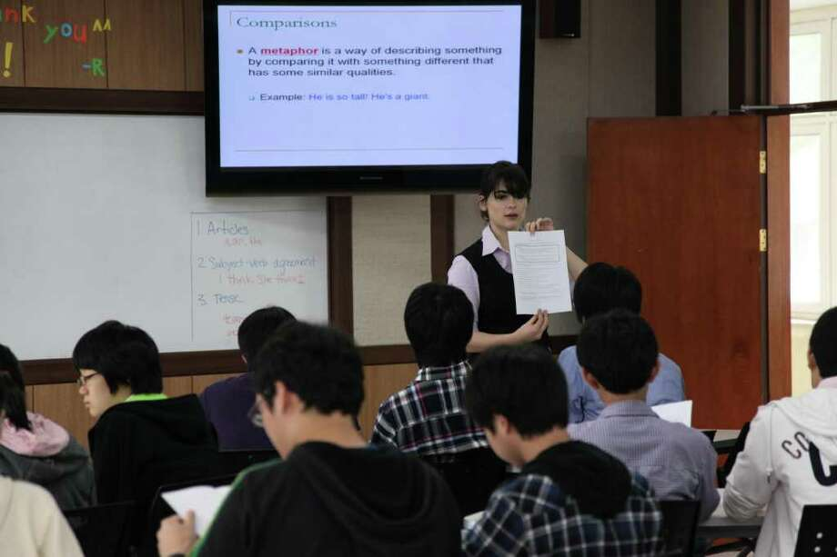 In her second year as a Fulbright fellow teaching English in the South Korea, Greenwich High School alumnus Dara Kaye is shown in front of her class in the undated photo. Photo: Contributed Photo / Greenwich Time Contributed