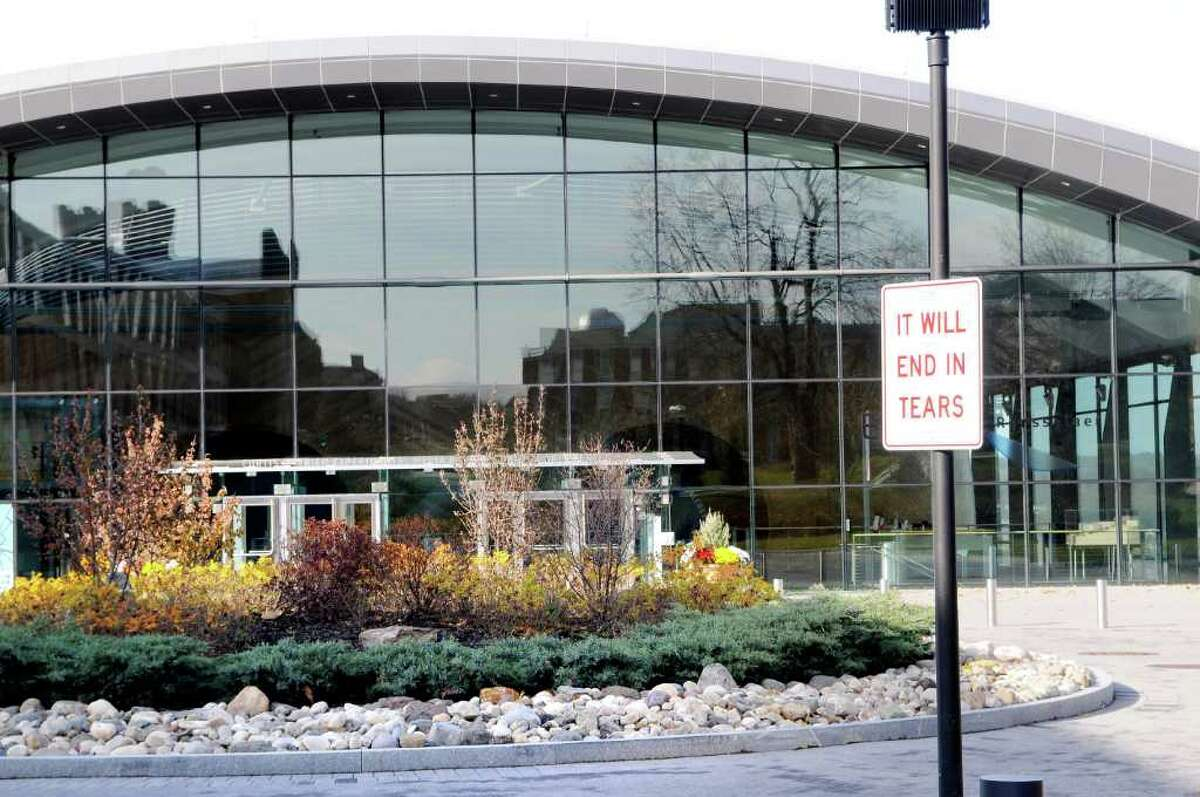 """With the Curtis R. Priem EMPAC Center in the background, one of the signs prepared by Anthony Discenza, called End in Tears, 2010, has been placed on a pole on the RPI Campus, as part of the """"Uncertain Spectator"""" Exhibition that opened with a reception and screening of """"Dancer in the Dark"""" on Thursday, Nov. 18, 2010, in the arts center with satellite pieces presented throughout the Troy, NY campus. The show runs thru January 29, 2010, and is an exhibition confronting anxiety in contemporary art that asks individuals to cross a threshold and to place themselves in situations riddled with tension, and to confront deeply charged emotional content and grapple with feelings of apprehension. (Luanne M. Ferris / Times Union)"""