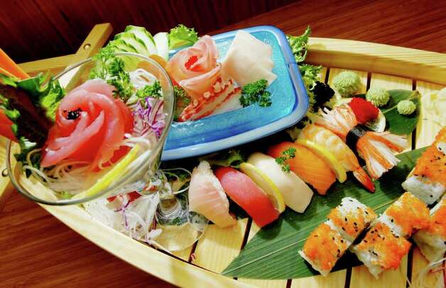 A sushi boat for one is among the beautifully presented for Asian cuisine mohegan lake menu