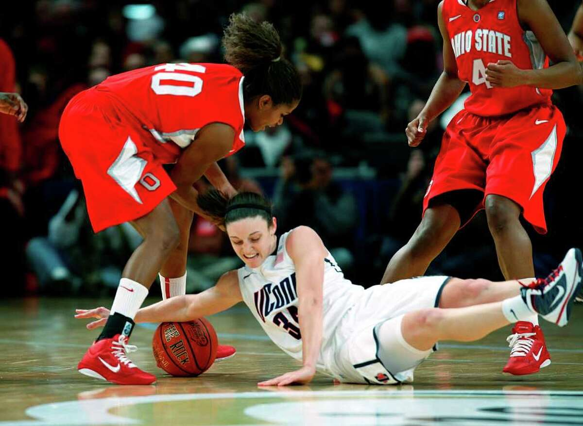 NEW YORK, NY - DECEMBER 19: Kelly Faris #34 of the Connecticut Huskies scrambles for a loose ball with Brittany Johnson #40 of the Ohio State Buckeyes in the Maggie Dixon Classic at Madison Square Garden on December 19, 2010 in New York City. (Photo by Jeff Zelevansky/Getty Images) *** Local Caption *** Kelly Faris;Brittany Johnson