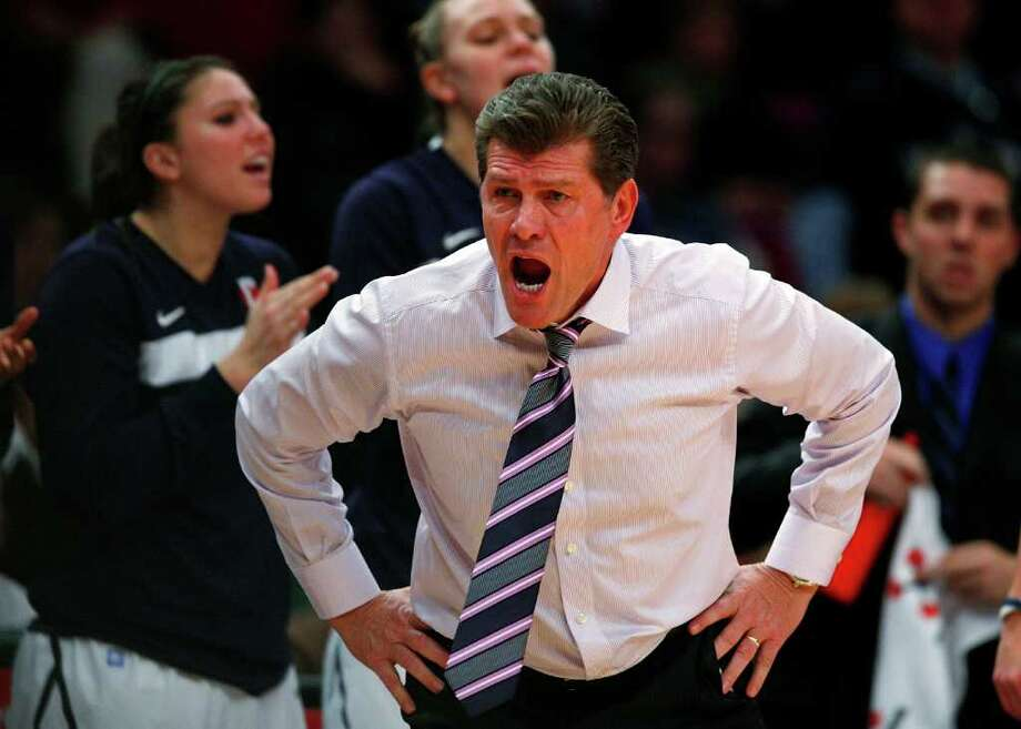 NEW YORK, NY - DECEMBER 19:  Geno Auriemma, head coach of the Connecticut Huskies yells from the sidelines against the Ohio State Buckeyes in the Maggie Dixon Classic at Madison Square Garden on December 19, 2010 in New York City.  (Photo by Jeff Zelevansky/Getty Images) *** Local Caption *** Geno Auriemma Photo: Jeff Zelevansky, Getty Images / 2010 Getty Images
