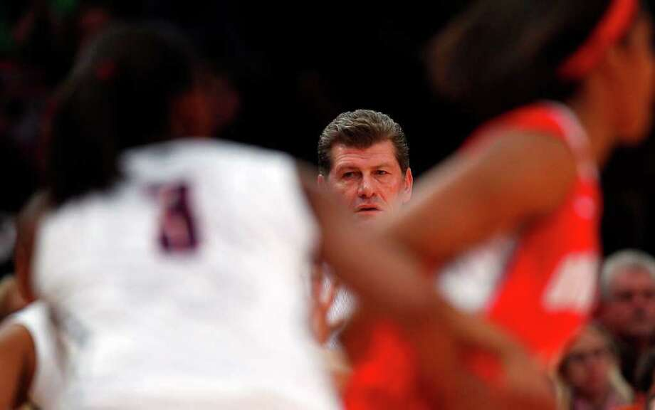 NEW YORK, NY - DECEMBER 19:  Geno Auriemma, head coach of the Connecticut Huskies works the sidelines against the Ohio State Buckeyes in the Maggie Dixon Classic at Madison Square Garden on December 19, 2010 in New York City.  (Photo by Jeff Zelevansky/Getty Images) *** Local Caption *** Geno Auriemma Photo: Jeff Zelevansky, Getty Images / 2010 Getty Images