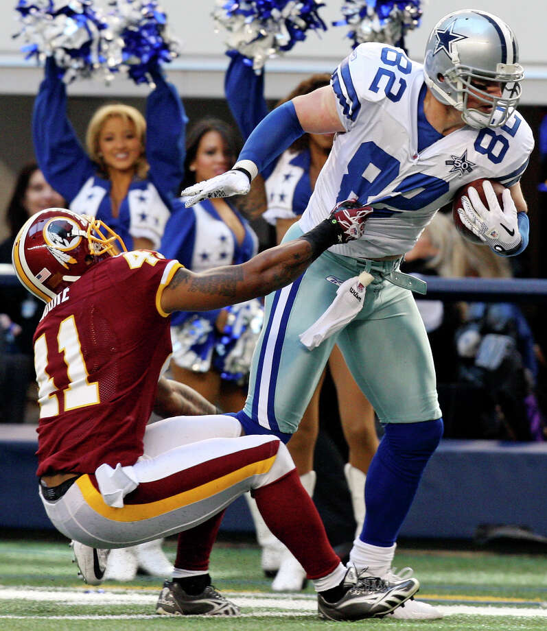The Dallas Cowboys' Jason Witten tries to shake the tackle of the Washington Redskins' Kareem Moore during the first half on Sunday, Dec. 19, 2010, at Cowboys Stadium in Arlington.  The Cowboys won 33-30. Photo: Edward A. Ornelas/Express-News