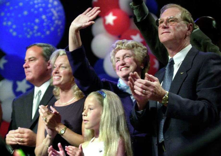 "Bridgeport_071302_Lt. Gov. Jodi Rell, second from right, waves to the crowd with her husband, Lou, right. Gov. John Rowland is at left with his wife, Patty. Caitlin Hale, 11, of Ansonia, center, sang ""God Bless America"" at the conclusion of the convention.  Kerry Sherck/Staff photo Photo: Kerry Sherck, ST / SCNI"