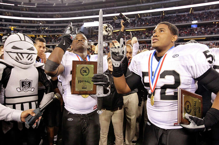 Steele Knights running back Malcolm Brown (left) and linebacker Ryan Simmons celebrate their 24-21 win over Denton Guyer in the Class 5A Division II state final Saturday at Cowboys Stadium in Arlington. Photo: Edward A. Ornelas/Express-News